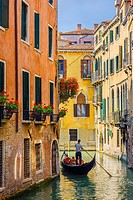 Gondola on a canal in Venice, Italy.