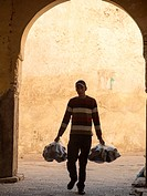 People walking down the street in the medina in Fez, Morrocco.