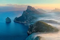Formentor peninsula and Colomer isle on a misty sunrise. Pollensa area. Majorca, Balearic islands, Spain