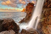 Northwest coast of Majorca. Sa Costera intermitent fresh water spring waterfall. Long exposure. Balearic islands, Spain.
