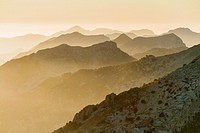 Central-southern Tramuntana mountains at sunset. Tossals Verts hill in the center. Aerial view. Majorca, Balearic islands, Spain