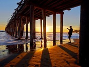 Silhouette of man at beach during sunset in Cayucas, California, United States.