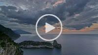 Winter evening view of La Foradada peninsula, as clouds move across the sunset. Northwest coast of Majorca, Deia area. Balearic islands, Spain. Tramun...