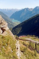 Mountain train at Alp Gruem, with the Valposchiavo in the background, Engadin, Switzerland.