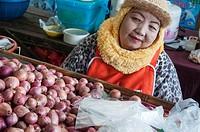 Stallholder at the morning market in Mae Hong Son, Thailand.