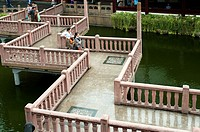 Zigzagging bridge crosses an ornamental lake at the Yu Bazaar, Shanghai, China. There is free access to this area, which is not a paid attraction.