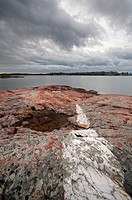 Incredible cloud formations and a White Quartzite strip running through Pink Granite covered in lichen along the shores of Georgian Bay in Killarney P...