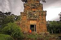 Buddhist Monk at the Temples of Kleangs & Prasat Suor Prat. Angkor Thom. Rectangular sandstone building set opposite the Terrace of Elephants, behind ...