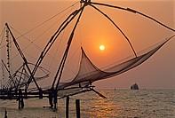 Chinese fishing nets at Kochi at sunset, State of Kerala, India, South Asia.