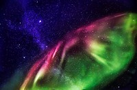 Starry evening with the Aurora Borealis or Northern Lights and the Milky Way Galaxy, Abisko, Lapland, Sweden.
