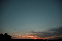 Beautiful Sunset and the Silhouettes of Electricity Towers. Aichi Prefecture, Japan