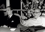 Luigi Vannucchi is cheerfully talking with Roberto Rossellini. Luigi Vannucchi (on the left) and Roberto Rosselliniare cheerfully talking at a table. ...