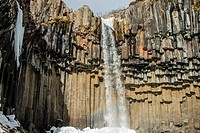 Well-known waterfall in iceland over a basaltic columnar system.