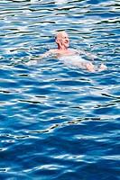 Senior man swimming in sea, Croatia