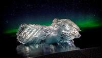 Ice with the Aurora Borealis. Ice formations come from the Jokulsarlon Glacial Lagoon, Breidamerkurjokull Glacier, Vatnajokull Ice Cap, Iceland.