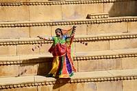 Rajasthani woman dancing on steps in Jaisalmer Rajasthan India MR#704