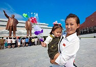 Mother And Daughter Going To Pay Respect To The Two Statues Of The Dear Leaders In Grand Monument Of Mansu Hill, Pyongyang, North Korea.