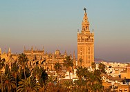 The Moorish Giralda (1184-96) next to the Gothic Cathedral (1402-1506). Seville, Seville province, Andalusia, Spain.