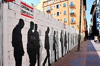 Graffiti depicting a line of unemployed, Saint Paul´s Quarter, Zaragoza, Spain
