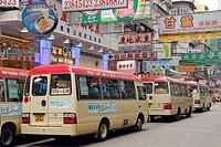 Hong Kong, China, Asia. Hong Kong Kowloon. Public transport by bus through Kowloon shopping area.