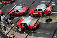 Hong Kong, China, Asia. Mirror image of typical Hong Kong Taxis.