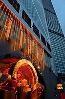 Hong Kong, China, Asia. Hong Kong Central. Decorated tower of the Bank of China (left) next the Cheung Kong Center (right).