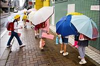 Schoolgirls with umbrellas in Tokyo, Japan.