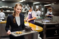 Kitchen of Das Stuen. Michelin-starred Catalan chef Paco Pérez in Das Stue Restaurant. Occupying a 1930s building that originally was Berlin´s Royal D...