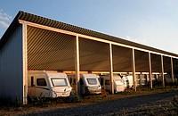 Caravans are under a solar power plant