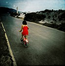 Girl learning has cycling on the beach of Benicassim, Castellon, Valencia, Spain