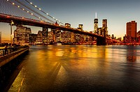 The Brooklyn Bridge, the East River and the Finanancial District with the new World Trade Center building , New York City at Sunset.