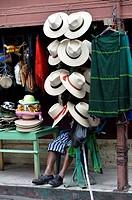 Vendor of straw hat in Santiago de Atitlan, Guatemala, Central America.