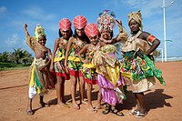 Colourfully dressed children of a traditional Afro-Brazilian musical group, Salvador da Bahia, Bahia, Brazil