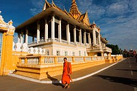 Monk walk outside the Royal Palace. Phnom Penh. The Royal Palace of Cambodia is a complex of buildings, even though it is generally understood to be t...