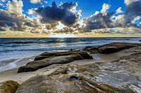 Clouds over the Pacific Ocean and rock formations on Windansea Beach. La Jolla, California, United States.