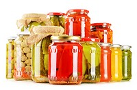 Composition with jars of pickled vegetables isolated on white. Marinated food.