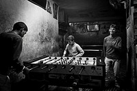Youngs playing table football in a games shop. Marrakesh or Marrakech, Morocco, North Africa.