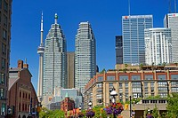 St Lawrence Market and Gooderham Flatiron building with financial district bank towers and CN tower Toronto.