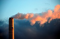 Smoke rises from the chimney of a factory in Germany