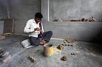 Artisan, Dokra metal art, at work in urban village, District Hazaribaug, Jharkhand, India