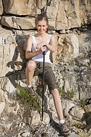 Athletic woman holding hiking pole smiling at camera