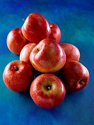 Pile of Red Apples on Blue
