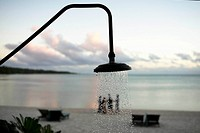 Aitutaki. Cook Island. Polynesia. South Pacific Ocean. Shower in the beach of the the luxurious Hotel Pacific Resort Aitutaki. Ocean. This Cook Island...