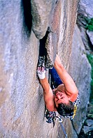 Rock climbing a route called Shake n Flake which is rated 5,10 and located on the Comp Wall at Castle Rocks State Park near the town of Almo in southe...