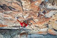 Rock climbing a route called Shes The Bosch which is rated 5,11 and located on Window Rock at the City Of Rocks National Reserve near the town of Almo...