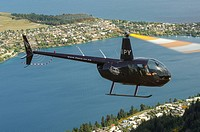 Robinson R44 helicopter in flight over Queenstown