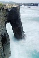 Arch in a beach called Praia das Catedrais in the north coast of Spain, Lugo, Spain.
