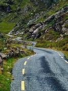 Narrow road winding through the Ballaghbeama Gap, County Kerry, Ireland.