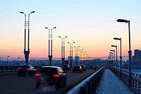 Cars on the bridge at sunset. Omsk. Russia.