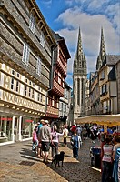 Kereon street, typical Half timbered houses, and cathedral Saint Corentin, with tourists, Quimper, Brittany, Finistere 29, France.